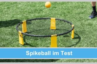 spikeball netz gelber ball grüne wiese